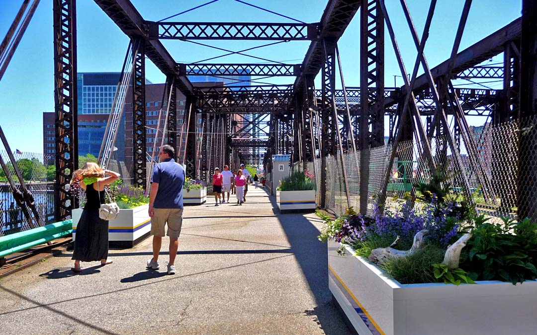 Northern avenue bridge-straight view-planters-lady and man walking-people in distance